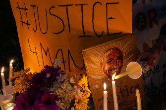 TACOMA, WA - JUNE 03: A person lights a candle at a vigil for Manuel Ellis, a black man whose March death while in Tacoma Police custody was recently found to be a homicide, according to the Pierce County Medical Examiners Office, on June 3, 2020 in Tacoma, Washington. Protests and other events sparked by the death of George Floyd have continued in the Tacoma area after the Medical Examiner found that the cause of death in the Manuel Ellis case was caused by respiratory arrest due to hypoxia due to physical restraint. (Photo by David Ryder/Getty Images)