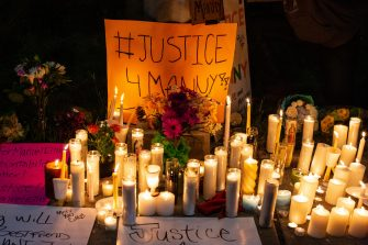 TACOMA, WA - JUNE 03: Candles and signs are seen during a vigil for Manuel Ellis, a black man whose March death while in Tacoma Police custody was recently found to be a homicide, according to the Pierce County Medical Examiners Office, near the site of his death on June 3, 2020 in Tacoma, Washington. Protests and other events sparked by the death of George Floyd have continued in the Tacoma area after the Medical Examiner found that the cause of death in the Manuel Ellis case was caused by respiratory arrest due to hypoxia due to physical restraint. (Photo by David Ryder/Getty Images)