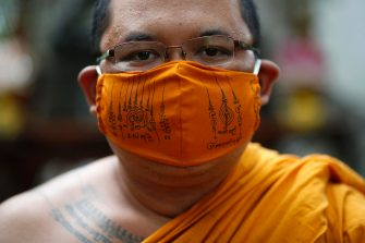 epa08470618 A Thai Buddhist monk wears a face mask made from recycled plastic bottles and inscribed with spiritual incantations aimed to protect devotees from the fear of the COVID-19 and coronavirus pandemic, at Wat Chak Daeng temple in Samut Prakan province, Thailand, 03 June 2020 (issued 07 June 2020). The Buddhist temple Wat Chak Daeng is well-known for managing the environmental campaign calling for donations of plastic bottles then transforming them into recycled fabrics before weaving and embroidering them into antibacterial robes. Amid the concerns of the ongoing spread of the COVID-19 disease, monks and volunteers produce facial mask made from used polyethylene terephthalate (PET) bottles collected by the temple's Buddhist monks, residents and donations aimed to control plastic waste as part of a waste management project to support environment protection and enhancing economic opportunities through recycled products. Thailand is one of the world's largest plastic polluters by generating more than two million tons of plastic waste each year.  EPA/RUNGROJ YONGRIT