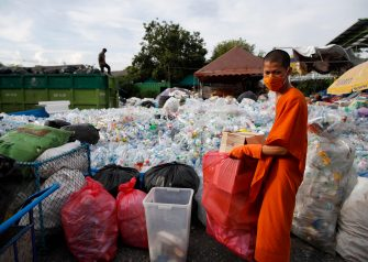 epa08470632 A Thai Buddhist monk sorts out recyclable plastic waste collected to produce recycled facial masks and monk's saffron robes amid the ongoing spread of the COVID-19 and coronavirus pandemic, at Wat Chak Daeng temple in Samut Prakan province, Thailand, 03 June 2020 (issued 07 June 2020). The Buddhist temple Wat Chak Daeng is well-known for managing the environmental campaign calling for donations of plastic bottles then transforming them into recycled fabrics before weaving and embroidering them into antibacterial robes. Amid the concerns of the ongoing spread of the COVID-19 disease, monks and volunteers produce facial mask made from used polyethylene terephthalate (PET) bottles collected by the temple's Buddhist monks, residents and donations aimed to control plastic waste as part of a waste management project to support environment protection and enhancing economic opportunities through recycled products. Thailand is one of the world's largest plastic polluters by generating more than two million tons of plastic waste each year.  EPA/RUNGROJ YONGRIT