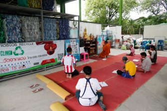 epa08470634 A Thai Buddhist monk and volunteers pray during an evening prayer ceremony next to recyclable plastic waste collected to produce recycled facial masks and monk's saffron robes amid the ongoing spread of the COVID-19 and coronavirus pandemic, at Wat Chak Daeng temple in Samut Prakan province, Thailand, 03 June 2020 (issued 07 June 2020). The Buddhist temple Wat Chak Daeng is well-known for managing the environmental campaign calling for donations of plastic bottles then transforming them into recycled fabrics before weaving and embroidering them into antibacterial robes. Amid the concerns of the ongoing spread of the COVID-19 disease, monks and volunteers produce facial mask made from used polyethylene terephthalate (PET) bottles collected by the temple's Buddhist monks, residents and donations aimed to control plastic waste as part of a waste management project to support environment protection and enhancing economic opportunities through recycled products. Thailand is one of the world's largest plastic polluters by generating more than two million tons of plastic waste each year.  EPA/RUNGROJ YONGRIT