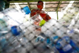 epa08470629 A Thai Buddhist monk sorts out recyclable plastic bottles to produce recycled facial masks and monk's saffron robes amid the ongoing spread of the COVID-19 and coronavirus pandemic, at Wat Chak Daeng temple in Samut Prakan province, Thailand, 03 June 2020 (issued 07 June 2020). The Buddhist temple Wat Chak Daeng is well-known for managing the environmental campaign calling for donations of plastic bottles then transforming them into recycled fabrics before weaving and embroidering them into antibacterial robes. Amid the concerns of the ongoing spread of the COVID-19 disease, monks and volunteers produce facial mask made from used polyethylene terephthalate (PET) bottles collected by the temple's Buddhist monks, residents and donations aimed to control plastic waste as part of a waste management project to support environment protection and enhancing economic opportunities through recycled products. Thailand is one of the world's largest plastic polluters by generating more than two million tons of plastic waste each year.  EPA/RUNGROJ YONGRIT