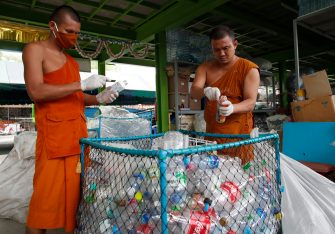 epa08470631 Thai Buddhist monks sort out recyclable plastic bottles to produce recycled facial masks and monk's saffron robes amid the ongoing spread of the COVID-19 and coronavirus pandemic, at Wat Chak Daeng temple in Samut Prakan province, Thailand, 03 June 2020 (issued 07 June 2020). The Buddhist temple Wat Chak Daeng is well-known for managing the environmental campaign calling for donations of plastic bottles then transforming them into recycled fabrics before weaving and embroidering them into antibacterial robes. Amid the concerns of the ongoing spread of the COVID-19 disease, monks and volunteers produce facial mask made from used polyethylene terephthalate (PET) bottles collected by the temple's Buddhist monks, residents and donations aimed to control plastic waste as part of a waste management project to support environment protection and enhancing economic opportunities through recycled products. Thailand is one of the world's largest plastic polluters by generating more than two million tons of plastic waste each year.  EPA/RUNGROJ YONGRIT