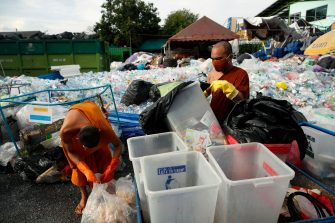 epa08470633 Thai Buddhist monks sort out recyclable plastic wastes to produce recycled face masks and monk's saffron robes amid the ongoing spread of the COVID-19 and coronavirus pandemic, at Wat Chak Daeng temple in Samut Prakan province, Thailand, 03 June 2020 (issued 07 June 2020). The Buddhist temple Wat Chak Daeng is well-known for managing the environmental campaign calling for donations of plastic bottles then transforming them into recycled fabrics before weaving and embroidering them into antibacterial robes. Amid the concerns of the ongoing spread of the COVID-19 disease, monks and volunteers produce facial mask made from used polyethylene terephthalate (PET) bottles collected by the temple's Buddhist monks, residents and donations aimed to control plastic waste as part of a waste management project to support environment protection and enhancing economic opportunities through recycled products. Thailand is one of the world's largest plastic polluters by generating more than two million tons of plastic waste each year.  EPA/RUNGROJ YONGRIT