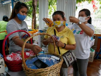 epa08470621 Thai people buy facial masks made from recycled plastic bottles amid the ongoing spread of the COVID-19 and coronavirus pandemic, at Wat Chak Daeng temple in Samut Prakan province, Thailand, 03 June 2020 (issued 07 June 2020). The Buddhist temple Wat Chak Daeng is well-known for managing the environmental campaign calling for donations of plastic bottles then transforming them into recycled fabrics before weaving and embroidering them into antibacterial robes. Amid the concerns of the ongoing spread of the COVID-19 disease, monks and volunteers produce facial mask made from used polyethylene terephthalate (PET) bottles collected by the temple's Buddhist monks, residents and donations aimed to control plastic waste as part of a waste management project to support environment protection and enhancing economic opportunities through recycled products. Thailand is one of the world's largest plastic polluters by generating more than two million tons of plastic waste each year.  EPA/RUNGROJ YONGRIT