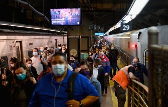 "Commuters arrive at Grand Central Station with Metro-North during morning rush hour on June 8, 2020 in New York City. - Today New York City enters ""Phase 1"" of a four-part reopening plan after spending more than two months under lockdown. New York City is the final region in the state to reopen its economy. (Photo by Angela Weiss / AFP) (Photo by ANGELA WEISS/AFP via Getty Images)"