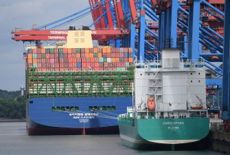 HAMBURG, GERMANY - JUNE 07: The HMM Algeciras, currently the world's largest container ship, arrives on its maiden voyage on June 07, 2020 in Hamburg, Germany. The ship is 399.9 meters long and 61 meters wide, and has a nominal capacity to transport 23,964 containers. It is the first in a series of twelve ships in the 24,000 TEU class and was built in South Korea. (Photo by Stuart Franklin/Getty Images)