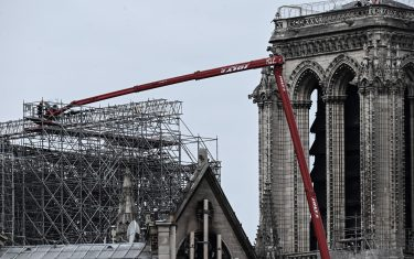 Workers are seen during the first day of the dismantling operations of the scaffolding at the Notre-Dame Cathedral in Paris on June 8, 2020 that was damaged in the April 15, 2019 blaze. (Photo by Philippe LOPEZ / AFP) (Photo by PHILIPPE LOPEZ/AFP via Getty Images)
