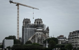 A picture shows the Notre-Dame Cathedral during the first day of the dismantling operations of the scaffolding in Paris on June 8, 2020 that was damaged in the April 15, 2019 blaze. (Photo by Philippe LOPEZ / AFP) (Photo by PHILIPPE LOPEZ/AFP via Getty Images)