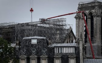 Workers take part in the dismantling operation of the scaffolding at the Notre-Dame Cathedral in Paris on June 8, 2020 that was damaged in the April 15, 2019 blaze. (Photo by Philippe LOPEZ / AFP) (Photo by PHILIPPE LOPEZ/AFP via Getty Images)