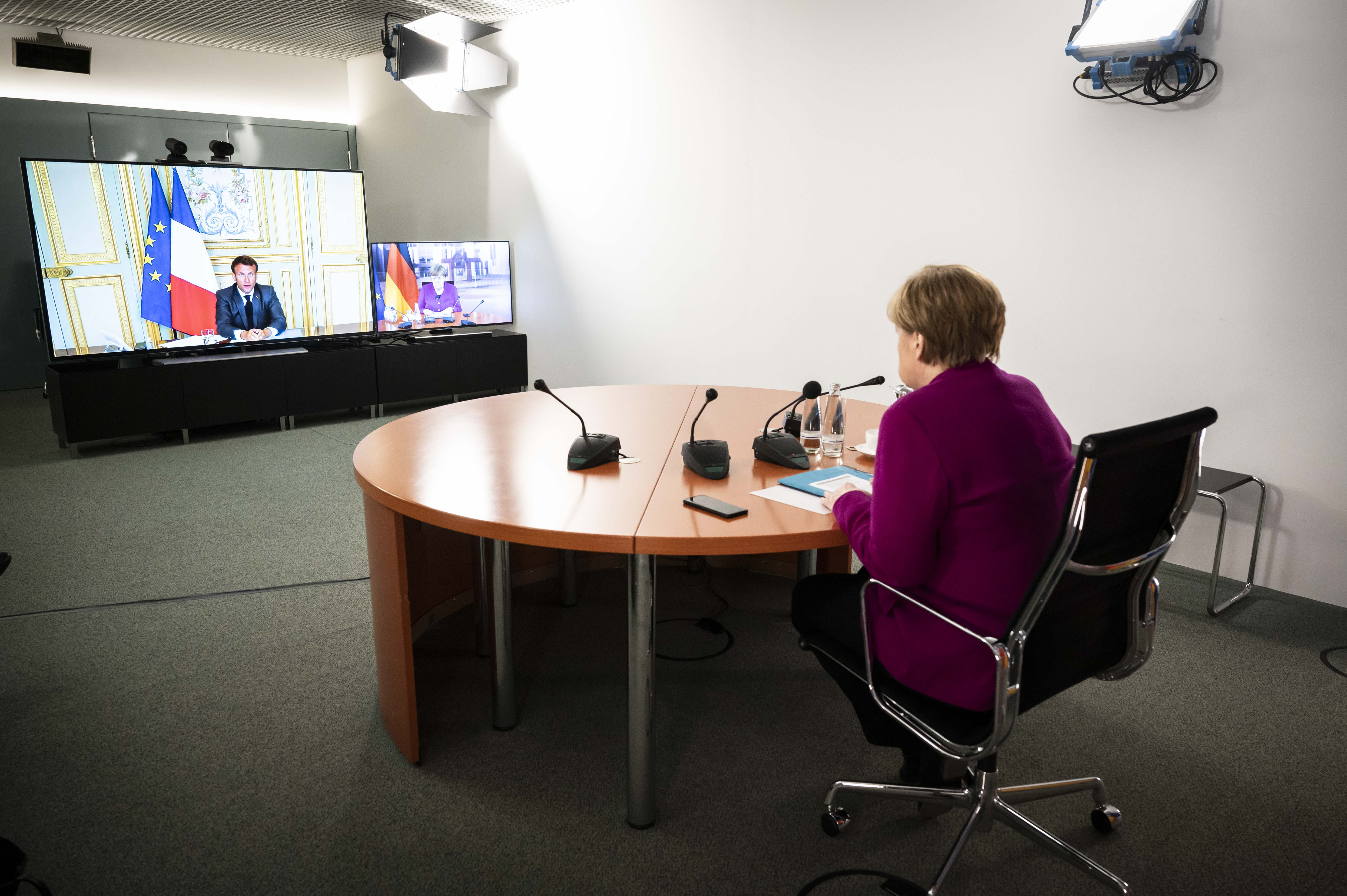 BERLIN, GERMANY - MAY 18, 2020:  In this handout photo provided by the German Government Press Office (BPA), German Chancellor Angela Merkel is seen during a video conference with French President Emmanuel Macron at the Chancellor's Office on May 18, 2020 in Berlin, Germany. (Photo by Sandra Steins/Bundesregierung via Getty Images)
