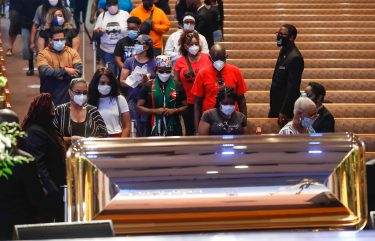 Mourners wait in line to pass by the casket of George Floyd during a public viewing at the Fountain of Praise church Monday, June 8, 2020, in Houston. (Photo by Godofredo A. VASQUEZ / POOL / AFP) (Photo by GODOFREDO A. VASQUEZ/POOL/AFP via Getty Images)
