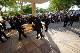 HOUSTON, TEXAS - JUNE 08: The casket of George Floyd is removed after a public visitation at the Fountain of Praise church on June 8, 2020 in Houston, Texas. Floyd died after being restrained by Minneapolis Police officers on May 25th. (Photo by David J. Phillip-Pool/Getty Images)
