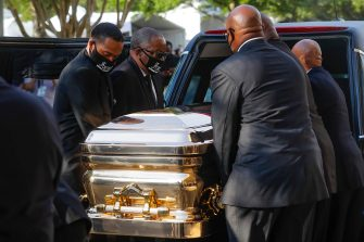 Pallbearers load George Floyd's casket into a hearse after after a public viewing at the Fountain of Praise church in Houston, Texas on June 8, 2020. - Democrats vowed June 7, 2020 to press legislation to fight systemic racism in US law enforcement as the battle for change triggered by the police killing of George Floyd began shifting from the streets to the political sphere.Demonstrations continued across the nation Sunday -- including in Washington, New York and Winter Park, Florida -- as protesters began focusing their initial outrage over the death of the unarmed Floyd into demands for police reform and social justice. (Photo by Godofredo A. VASQUEZ / POOL / AFP) (Photo by GODOFREDO A. VASQUEZ/POOL/AFP via Getty Images)