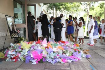 HOUSTON, TEXAS - JUNE 09: Family and friends of George Floyd enter the Fountain of Praise church for his funeral on June 9, 2020 in Houston, Texas. Floyd died May 25 while in Minneapolis police custody, sparking nationwide protests. (Photo by Joe Raedle/Getty Images)