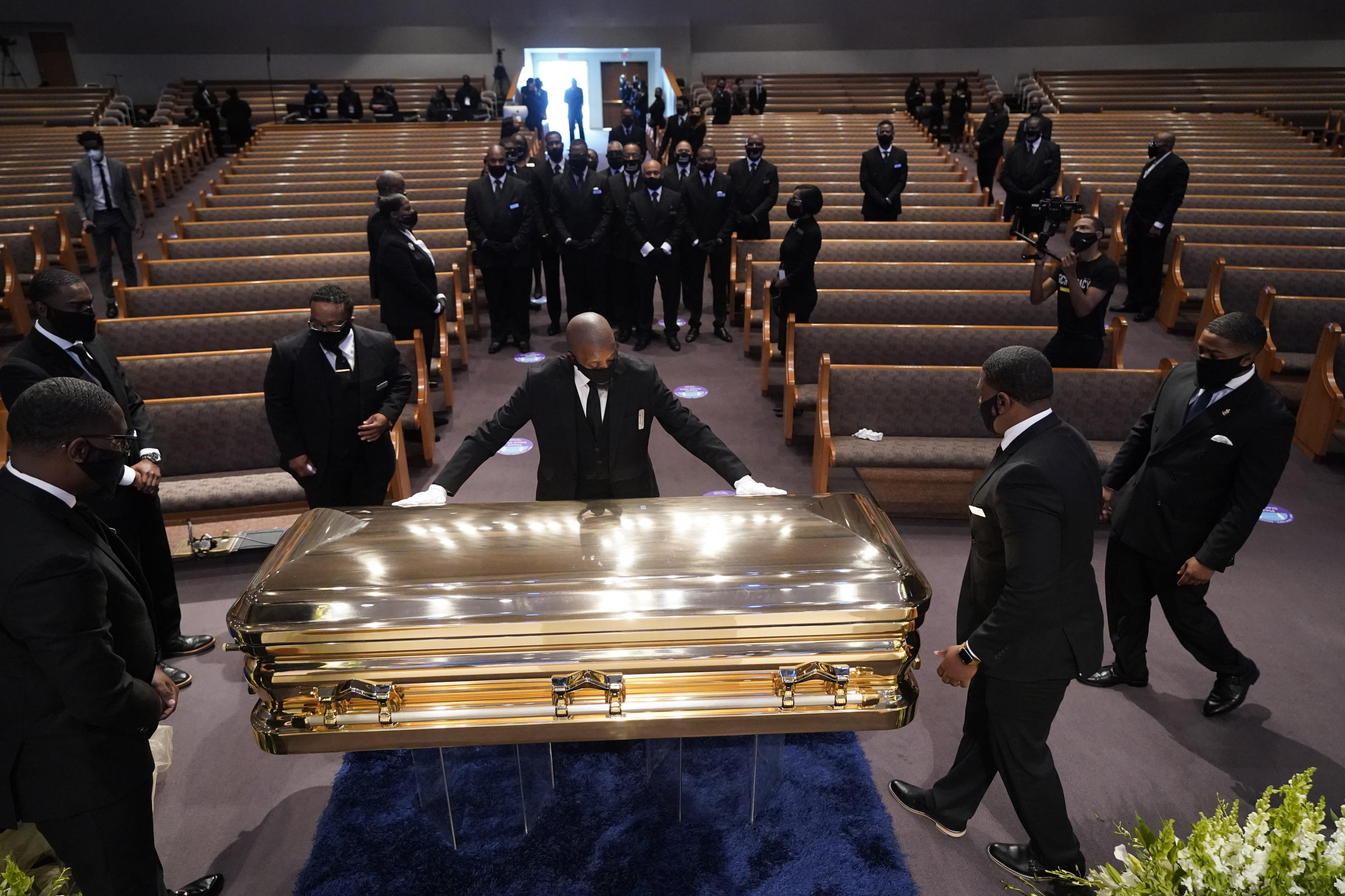 epa08474920 The casket of George Floyd is placed in the chapel during a funeral service for Floyd at the Fountain of Praise church, Houston, Texas, USA, 09 June 2020. A bystander's video posted online on 25 May, appeared to show George Floyd, 46, pleading with arresting officers that he couldn't breathe as an officer knelt on his neck. The unarmed Black man later died in police custody and all four officers involved in the arrest have been charged and arrested.  EPA/David J. Phillip / POOL