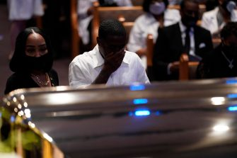 epa08475209 Mourners pause by the casket during a funeral service for George Floyd at the Fountain of Praise church, Houston, Texas, USA, 09 June 2020. A bystander's video posted online on 25 May, appeared to show George Floyd, 46, pleading with arresting officers that he couldn't breathe as an officer knelt on his neck. The unarmed Black man later died in police custody and all four officers involved in the arrest have been charged and arrested.  EPA/David J. Phillip / POOL