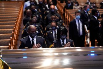 epa08475194 Members of the Texas Southern University police department pause during a funeral service for George Floyd at the Fountain of Praise church, Houston, Texas, USA, 09 June 2020. A bystander's video posted online on 25 May, appeared to show George Floyd, 46, pleading with arresting officers that he couldn't breathe as an officer knelt on his neck. The unarmed Black man later died in police custody and all four officers involved in the arrest have been charged and arrested.  EPA/David J. Phillip / POOL