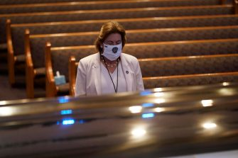 epa08475100 Harris County District Attorney Kimm Ogg, pauses by the casket of George Floyd during a funeral service for Floyd at the Fountain of Praise church, Houston, Texas, USA, 09 June 2020. A bystander's video posted online on 25 May, appeared to show George Floyd, 46, pleading with arresting officers that he couldn't breathe as an officer knelt on his neck. The unarmed Black man later died in police custody and all four officers involved in the arrest have been charged and arrested.  EPA/David J. Phillip / POOL