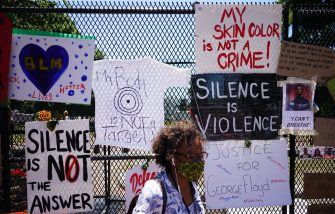 Messages are attached to the security fence on the north side of Lafayette Square, near the White House, in Washington, DC on June 8, 2020. - On May 25, 2020, Floyd, a 46-year-old black man suspected of passing a counterfeit $20 bill, died in Minneapolis after Derek Chauvin, a white police officer, pressed his knee to Floyd's neck for almost nine minutes. (Photo by MANDEL NGAN / AFP) (Photo by MANDEL NGAN/AFP via Getty Images)