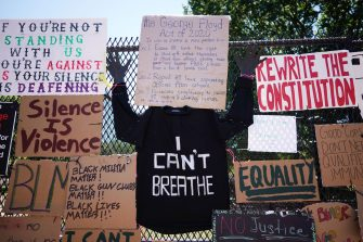 TOPSHOT - Messages are attached to the security fence on the north side of Lafayette Square, near the White House, in Washington, DC on June 8, 2020. - On May 25, 2020, Floyd, a 46-year-old black man suspected of passing a counterfeit $20 bill, died in Minneapolis after Derek Chauvin, a white police officer, pressed his knee to Floyd's neck for almost nine minutes. (Photo by MANDEL NGAN / AFP) (Photo by MANDEL NGAN/AFP via Getty Images)
