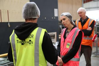 TAURANGA, NEW ZEALAND - JUNE 09: Prime Minister Jacinda Ardern (R) meets and talks to staff during the visit to Trevelyanâ  s Kiwifruit and Avocado Packhouse on June 09, 2020 in Tauranga, New Zealand. COVID-19 restrictions were lifted from midnight as New Zealand moved to COVID-19 Alert Level 1 as the government confirmed there are zero active cases in the country. The lifting of restrictions under Alert Level 1 will see life mostly return to normal in New Zealand, however strict border measures will remain with mandatory isolation and quarantine for any overseas arrivals. New Zealanders are also being asked to keep diaries in the event of a second wave of infections. (Photo by Michael Bradley/Getty Images)