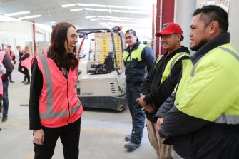 TAURANGA, NEW ZEALAND - JUNE 09: Prime Minister Jacinda Ardern (L) meets and talks to staff during the visit to Trevelyanâ  s Kiwifruit and Avocado Packhouse on June 09, 2020 in Tauranga, New Zealand. COVID-19 restrictions were lifted from midnight as New Zealand moved to COVID-19 Alert Level 1 as the government confirmed there are zero active cases in the country. The lifting of restrictions under Alert Level 1 will see life mostly return to normal in New Zealand, however strict border measures will remain with mandatory isolation and quarantine for any overseas arrivals. New Zealanders are also being asked to keep diaries in the event of a second wave of infections. (Photo by Michael Bradley/Getty Images)