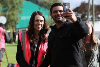 TAURANGA, NEW ZEALAND - JUNE 09: Prime Minister Jacinda Ardern (L) has a selfie taken as she meets and talks to staff during the visit to Trevelyanâ  s Kiwifruit and Avocado Packhouse on June 09, 2020 in Tauranga, New Zealand. COVID-19 restrictions were lifted from midnight as New Zealand moved to COVID-19 Alert Level 1 as the government confirmed there are zero active cases in the country. The lifting of restrictions under Alert Level 1 will see life mostly return to normal in New Zealand, however strict border measures will remain with mandatory isolation and quarantine for any overseas arrivals. New Zealanders are also being asked to keep diaries in the event of a second wave of infections. (Photo by Michael Bradley/Getty Images)
