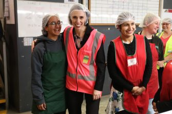 TAURANGA, NEW ZEALAND - JUNE 09: Prime Minister Jacinda Ardern (C) meets and talks to staff during the visit to Trevelyanâ  s Kiwifruit and Avocado Packhouse on June 09, 2020 in Tauranga, New Zealand. COVID-19 restrictions were lifted from midnight as New Zealand moved to COVID-19 Alert Level 1 as the government confirmed there are zero active cases in the country. The lifting of restrictions under Alert Level 1 will see life mostly return to normal in New Zealand, however strict border measures will remain with mandatory isolation and quarantine for any overseas arrivals. New Zealanders are also being asked to keep diaries in the event of a second wave of infections. (Photo by Michael Bradley/Getty Images)