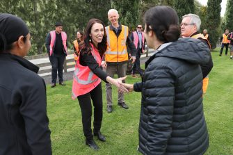 TAURANGA, NEW ZEALAND - JUNE 09: Prime Minister Jacinda Ardern meets and talks to staff during the visit to Trevelyanâ  s Kiwifruit and Avocado Packhouse on June 09, 2020 in Tauranga, New Zealand. COVID-19 restrictions were lifted from midnight as New Zealand moved to COVID-19 Alert Level 1 as the government confirmed there are zero active cases in the country. The lifting of restrictions under Alert Level 1 will see life mostly return to normal in New Zealand, however strict border measures will remain with mandatory isolation and quarantine for any overseas arrivals. New Zealanders are also being asked to keep diaries in the event of a second wave of infections. (Photo by Michael Bradley/Getty Images)
