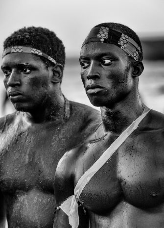 """""""Wrestling has become the number one national sport in Senegal, ahead of football, and has also become a means of social ascendance. For many, it's a slice of African life, tradition and culture, in which there is a curious mix of animist and Muslim beliefs. These pictures show wrestlers training on a beach in Dakar. """""""