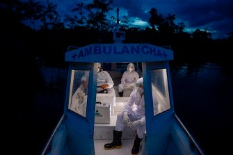 TOPSHOT - Health workers from the city of Melgaco ride a boat ambulance on their way back after visiting eight families that live without electricity in a small riverside community at the Quara river, amid concern over the spread of the COVID-19 coronavirus, in the southwest of Marajo Island, state of Para, Brazil, on June 9, 2020. (Photo by TARSO SARRAF / AFP) (Photo by TARSO SARRAF/AFP via Getty Images)