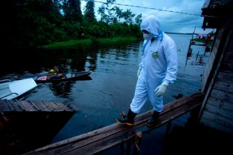 A health worker from the city of Melgaco arrives to a small riverside community at the Quara river, where eight families live without electricity, to give medical care to its residents amid concern over the spread of the COVID-19 coronavirus, in the southwest of Marajo Island, state of Para, Brazil, on June 9, 2020. (Photo by TARSO SARRAF / AFP) (Photo by TARSO SARRAF/AFP via Getty Images)