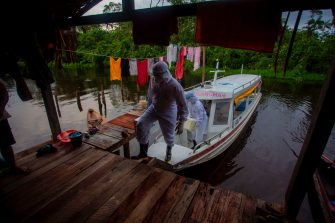 Health workers from the city of Melgaco arrive to a small riverside community at the Quara river, where eight families live without electricity, to give medical care to its residents amid concern over the spread of the COVID-19 coronavirus, in the southwest of Marajo Island, state of Para, Brazil, on June 9, 2020. (Photo by TARSO SARRAF / AFP) (Photo by TARSO SARRAF/AFP via Getty Images)