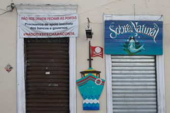"""RIO DE JANEIRO, BRAZIL - JUNE 09: A traditional restaurant in the Santa Teresa neighborhood shuttered and closed with a banner that reads in Portuguese """"Don't let us close the doors. We need immediate support from banks and the government. #DontLetTheTabClose"""" amidst the coronavirus (COVID-19) pandemic on June 9, 2020 in Rio de Janeiro, Brazil. Many businesses in the city of Rio de Janeiro went bankrupt and some commercial spaces are either for sale or for lease during the coronavirus (COVID-19) pandemic. (Photo by Bruna Prado/Getty Images)"""