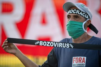 BRASILIA, BRAZIL - JUNE 09:Protesters protest against Brazilian President Jair Bolsonaro amidstthe coronavirus (COVID-19) pandemic in front of theTribunal Superior Eleitoralon June 09, 2020 in Brasilia.TheTribunal Superior Eleitoralresumed the trial of two Investigation Actions that ask for the cancellation of the candidacy records and the mandates of the president and vice president of Brazil.Brazil has over 739,000 confirmed positive cases of Coronavirus and 38,406 deaths. (Photo by Andressa Anholete/Getty Images)
