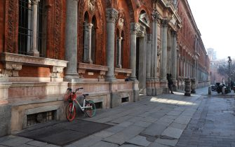 MILAN, ITALY - FEBRUARY 26: Via Festa del Perdono usually full of hundreds of university students is seen empty in front of the main university building of the Università degli Studi on February 26, 2020 in Milan, Italy.  The country is struggling to understand how it went from six coronavirus cases to 374 cases and 12 dead since last Friday, becoming Europe's worst-affected country. Many communities across the Lombardy and Veneto regions have seen the suspension of public events and church services, and the closure of grade schools, universities and museums. Twelve towns have been locked down entirely, with road blocks preventing the exit and entrance of people. The government has also imposed quarantines for those who have had close contact with confirmed cases of the illness. (Photo by Marco Di Lauro/Getty Images)