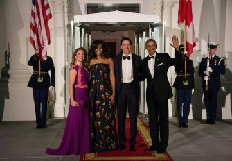US President Barack Obama (R), Canadian Prime Minister Justin Trudeau (2nd R) and their wives Michelle Obama (2nd L) and Sophie Gregoire Trudeau (L) pose u[pon the Trudeau's arrival for a State Dinner in their honor at the White House in Washington, DC, on March 10, 2016. / AFP / Nicholas Kamm        (Photo credit should read NICHOLAS KAMM/AFP via Getty Images)