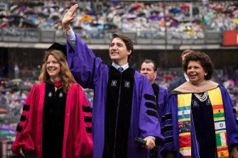 NEW YORK, NY - MAY 16: Canadian Prime Minister Justin Trudeau waves as he arrives for New York University's commencement ceremony at Yankee Stadium, May 16, 2018 in the Bronx borough of New York City. Trudeau, who was honored with a honorary doctor of laws degree, is delivering a commencement address to the graduating class of 2018. (Photo by Drew Angerer/Getty Images)