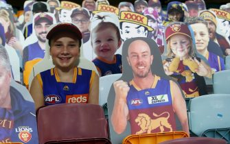 BRISBANE, AUSTRALIA - JUNE 13: A cardboard cut out of Chris Lynn is seen with other fans before the round 2 AFL match between the Brisbane Lions and the Fremantle Dockers at The Gabba on June 13, 2020 in Brisbane, Australia. (Photo by Jono Searle/AFL Photos/Getty Images)