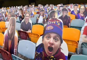 epa08481921 Cardboard cutouts of Brisbane Lions supporters are placed on empty seats during Round 2 of the Australian Football League (AFL) match between the Brisbane Lions and the Fremantle Dockers at The Gabba in Brisbane, Australia, 13 June 2020. AFL games are currently being held behind closed doors amid the coronavirus pandemic and restrictions on mass gatherings.  EPA/DARREN ENGLAND EDITORIAL USE ONLY AUSTRALIA AND NEW ZEALAND OUT