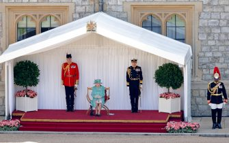 WINDSOR, UNITED KINGDOM - JUNE 13: (EMBARGOED FOR PUBLICATION IN UK NEWSPAPERS UNTIL 24 HOURS AFTER CREATE DATE AND TIME) Queen Elizabeth II, accompanied by Lieutenant Colonel Michael Vernon (Comptroller of the Lord Chamberlain's Office), Vice Admiral Tony Johnstone-Burt (Master of the Household) and her equerry Lieutenant Colonel Nana Kofi Twumasi-Ankrah (r), attends a military ceremony in the Quadrangle of Windsor Castle to mark her Official Birthday on June 13, 2020 in Windsor, England. It was decided that due to the ongoing COVID-19 Pandemic The Queen's Birthday Parade, known as Trooping the Colour, would not go ahead in it's traditional form at Buckingham Palace and Horse Guards Parade, but a small military ceremony in line with the Government's Social Distancing Guidelines would take place at Windsor Castle instead. Soldiers of 1st Battalion Welsh Guards (whose Colour was due to be Trooped this year) will carry out a series of military drills and Royal Salute. (Photo by Max Mumby/Indigo/Getty Images)