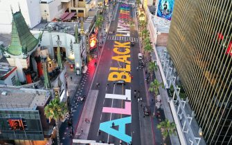 LOS ANGELES, CALIFORNIA  - JUNE 13: An aerial view of Hollywood Boulevard painted with the words 'All Black Lives Matterâ   near the famous TCL Chinese Theatre (L) as protests continue in the wake of George Floydâ  s death on June 13, 2020 in Los Angeles, California. George Floyd died on May 25th when he was in Minneapolis police custody, sparking nationwide protests. A white police officer, Derek Chauvin, has been charged with second-degree murder, with the three other officers involved facing other charges. (Photo by Mario Tama/Getty Images)