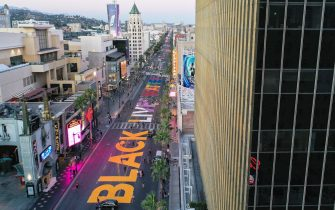 LOS ANGELES, CALIFORNIA  - JUNE 13: An aerial view of Hollywood Boulevard painted with the words 'Black Lives Matterâ   as protests continue in the wake of George Floydâ  s death on June 13, 2020 in Los Angeles, California. The message, fully displayed as 'All Black Lives Matter', was painted in rainbow colors to represent diversity within the black LGBTQ+ community amid Pride celebrations supporting the Black Lives Matter movement. George Floyd died on May 25th when he was in Minneapolis police custody, sparking nationwide protests. A white police officer, Derek Chauvin, has been charged with second-degree murder, with the three other officers involved facing other charges. (Photo by Mario Tama/Mario Tama/Getty Images)