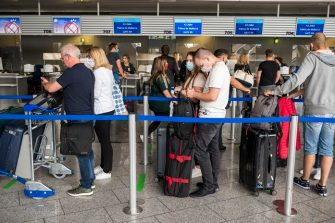FRANKFURT AM MAIN, GERMANY - JUNE 15: Tourists wait to check in for a TUIfly flight to Mallorca at Frankfurt Airport on the first day that package tours are resuming since March during the coronavirus pandemic on June 15, 2020 in Frankfurt, Germany. The travellers are participating in a test project in which the Spanish government is allowing up to 11,000 tourists from Germany to travel to the Balearic Islands. Spain, which was hit especially hard by Covid-19, has begun to ease pandemic lockdown measures, though tourist travel is still restricted. The project is meant to test the viability of reopening the country to tourism. (Photo by Thomas Lohnes/Getty Images)