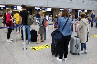 DUSSELDORF, GERMANY - JUNE 15: Tourists wait to check in for TUIfly flight X3 2312, the first package tour flight to Mallorca since March, at Dusseldorf Airport during the coronavirus pandemic on June 15, 2020 in Dusselfdorf, Germany. The travellers are participating in a test project in which the Spanish government is allowing up to 11,000 tourists from Germany to travel to the Balearic Islands. Spain, which was hit especially hard by Covid-19, has begun to ease pandemic lockdown measures, though tourist travel is still restricted. The project is meant to test the viability of reopening the country to tourism. (Photo by Andreas Rentz/Getty Images)