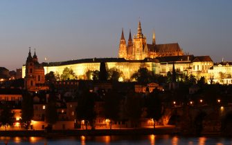 PRAGUE, CZECH REPUBLIC - OCTOBER 28: Twilight descends upon Prague Castle, also called Hradcany Castle, October 28, 2003 in Prague, Czech Republic. Prague Castle, which also contains the Czech presidential offices, is one of the city's major landmarks and tourist attractions. Below it is the Lesser Town District and the Charles Bridge.    (Photo by Sean Gallup/Getty Images)