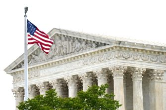 The US flag flies over the US Supreme Court that released a decision that says federal law protects LGBTQ workers from discrimination on June 15, 2020 in Washington,DC. (Photo by JIM WATSON / AFP)