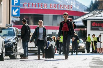 MATREI AM BRENNER, AUSTRIA - MARCH 11: A couple from Germany cross the border between Austria and Italy after arriving at the Brenner Pass near Matrei am Brenner on March 11, 2020 near Matrei am Brenner, Austria. Austrian Chancellor Sebastian Kurz yesterday announced Austria is turning away people arriving from Italy, except those with a doctor's certificate, in a measure to prevent the spread of the coronavirus. Freight is still being allowed in and any Austrians arriving will also be admitted but will need to submit to quarantine. The Italian government yesterday imposed nationwide measures in a bid to slow the spread of the virus, which has topped 9,100 confirmed cases in Italy. (Photo by Jan Hetfleisch/Getty Images)