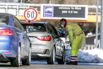 MATREI AM BRENNER, AUSTRIA - MARCH 11: A man in protective gear is seen with an clinical thermometer to check the temperature of the passengers in cars arriving from Italy at the Brenner Pass border crossing on March 11, 2020 near Matrei am Brenner, Austria. Austrian Chancellor Sebastian Kurz yesterday announced Austria is turning away people arriving from Italy, except those with a doctor's certificate, in a measure to prevent the spread of the coronavirus. Freight is still being allowed in and any Austrians arriving will also be admitted but will need to submit to quarantine. The Italian government yesterday imposed nationwide measures in a bid to slow the spread of the virus, which has topped 9,100 confirmed cases in Italy. (Photo by Jan Hetfleisch/Getty Images)